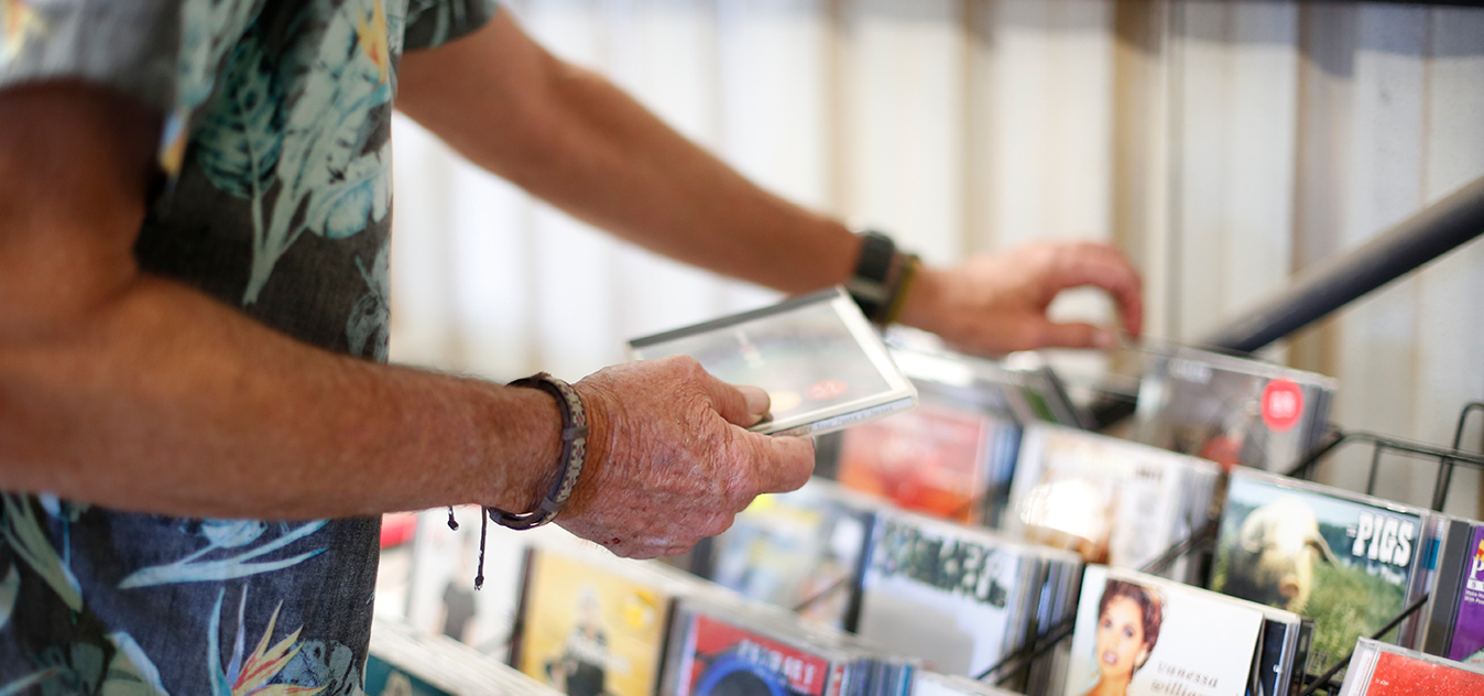 A Recycling Shop customer browses through some previously loved CD's